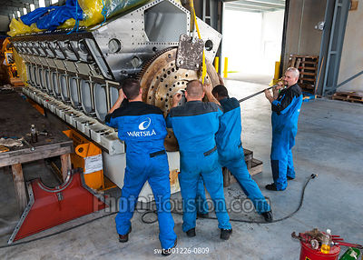 Men working on a Wartsila 32 diesel engine block