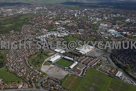 Oldham aerial photograph of  the area surrounding Oldham Football Stadium and the Royal Oldham Hospital looking towards Oldham town centre