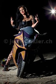 Desiree on her Hayabusa (fastest serial street bike), Louis Vuitton style air brushed..Light: Ranger Rx Speed AS,  21° with grid from 8:00h, high up and 430Ex as Hairlight 1/32, from 1:00h, Skyport