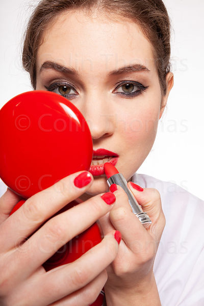 Cool teenager with lipstick, compact, pen photos