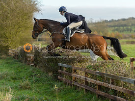 Rachel Finnegan jumping a hedge on Deane Bank