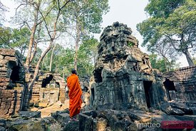Buddhist monk stading in front of temple, Angkor, Cambodia