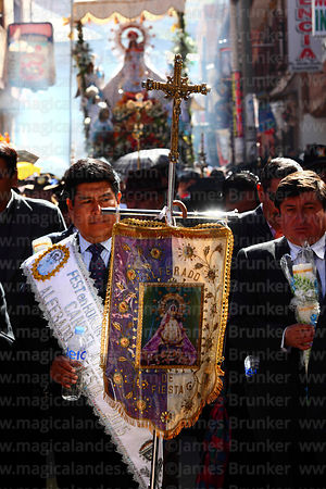 Hosting family (alferado) leading the main procession for Virgen de la Candelaria festival, Puno, Peru
