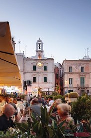 People dining at outdoor restaurant, Polignano a Mare, Apulia, Italy