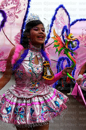 Girl dressed as an angel dancing the diablada, Virgen de la Candelaria festival, Puno, Peru