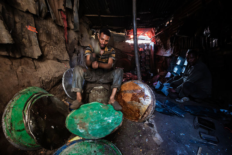 Workers Pounding Old Oil Drums to Make Pans