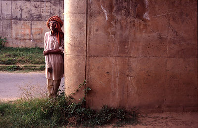 India - Chandigarh - A man rests by a concrere pillar in Chandigarh