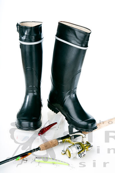 Rubber boots with fishing equipment
