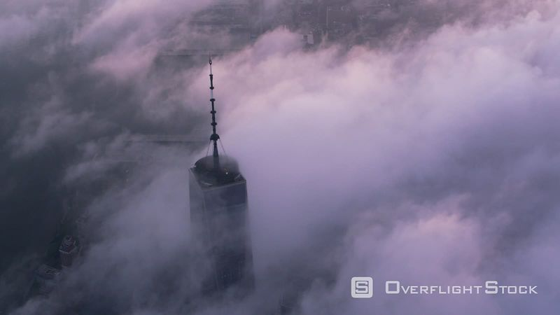 New York City Aerial view of One World Trade Center building with low clouds at sunrise.  Shot with Cineflex and RED EpicW Helium.