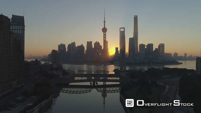 Panoramic Shanghai Skyline at Sunrise. Lujiazui Financial District and Huangpu River. China. Aerial View. Drone is Flying Forward and Upward. Establishing Shot.