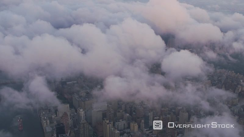 New York City Aerial view looking through low clouds at Manhattan.  Shot with Cineflex and RED EpicW Helium.