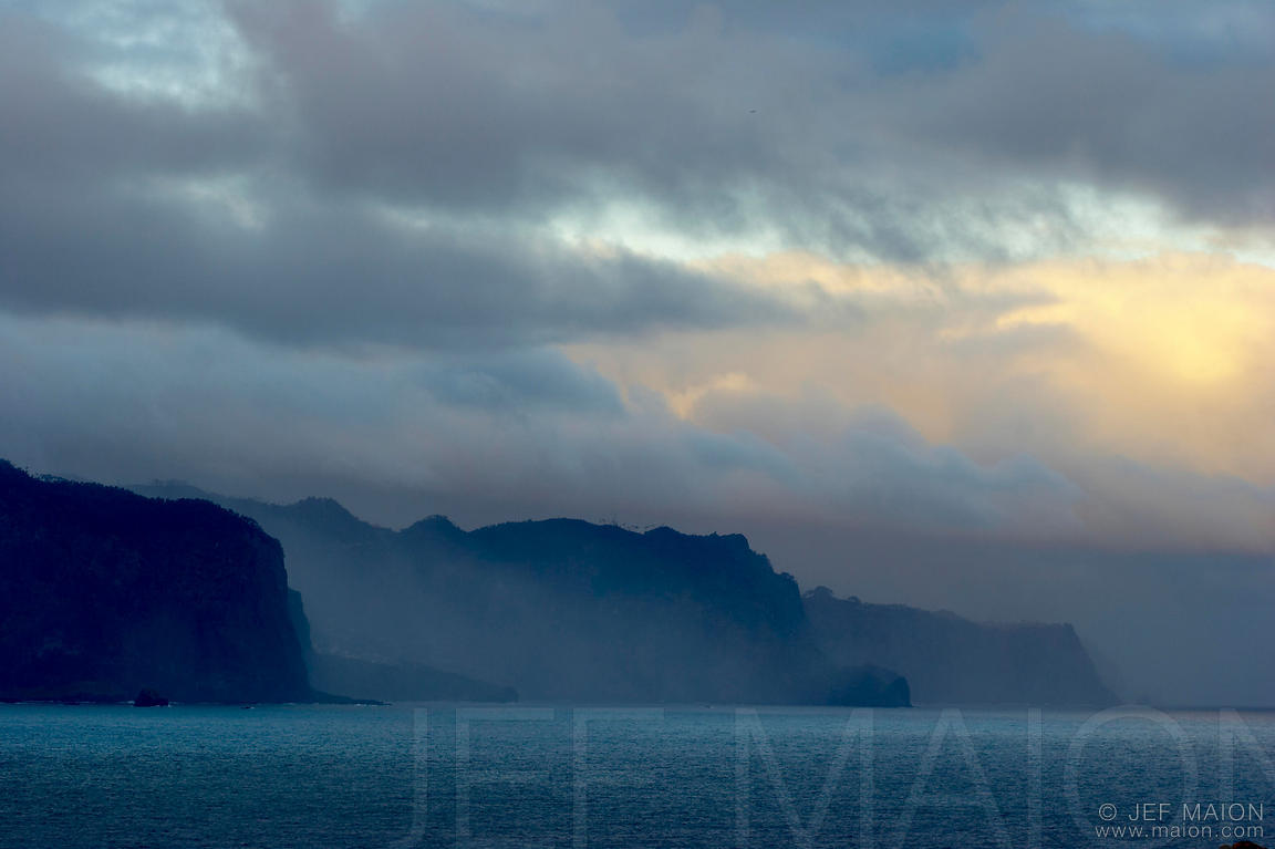 Misty sea cliffs at sunrise