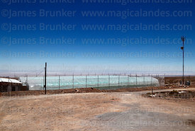 Greenhouse for growing vegetables, Salar de Atacama in distance, Socaire, Region II, Chile
