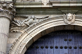 Detail of carving of angel playing trumpet above main entrance of cathedral, Lima, Peru