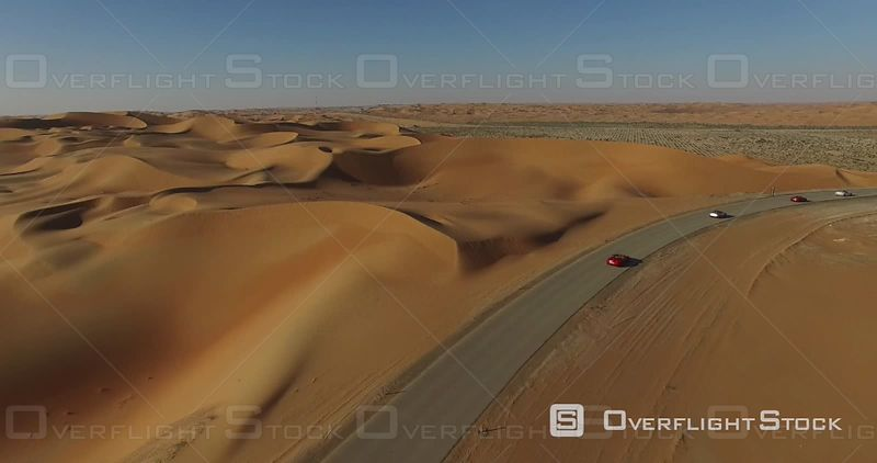 Cars Driving on a Desert Road, Filmed by Drone, United Arab Emirates