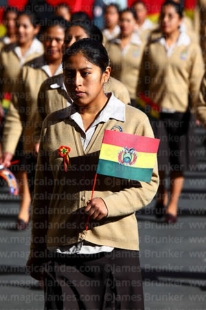 Schoolgirl carrying Bolivian flag during Independence Day parades, La Paz, Bolivia