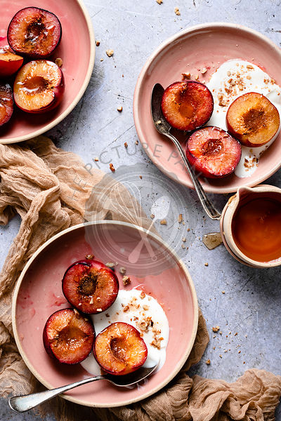 Roasted Red Plums and Greek Yogurt in pink bowls
