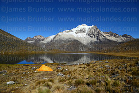 Campsite next to lake, Mt Huayna Potosí in background, Cordillera Real, Bolivia