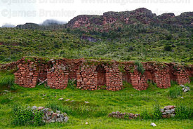 Stone wall with niches in Inca site of Huchuy Qosqo, Cusco Region, Peru