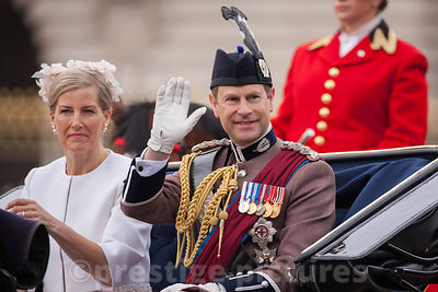 Prince Edward, Earl of Wessex waves to the Crowd as he Rides with his wife Sophie, Countess of Wessex in an open carriage to the Trooping the Colour Ceremony from Buckingham Palace