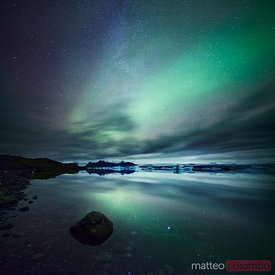 Aurora borealis (Northern lights) over glacial lagoon in Iceland