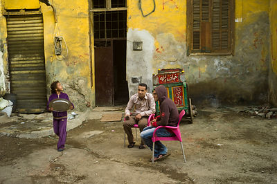 Egypt - Cairo - Two men sit in an alleyway in the, Bein al-Qasreen area, Islamic Cairo