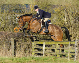 Gaby Cooke jumping a hunt jump at Lambing's