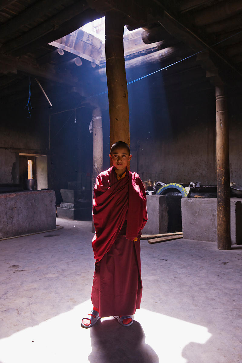Young Monk in Smoky Monastery Kitchen