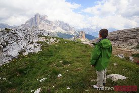 Young hiker looking at the mountains
