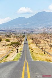 Empty road leading to volcano, Guanacaste, Costa Rica