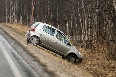 Small car crashed off the road into a steep ditch in Icy Weather