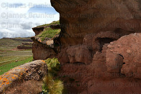 Pre Columbian tombs on ledge in Tinajani Canyon , Puno department , Peru