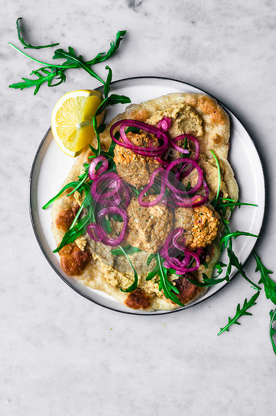 Red Lentil Falafel with Hummus, Naan, Greens, and Pickled Onions