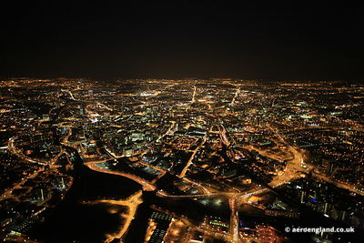 night aerial photograph of the  Manchester City Centre taken in full darkness