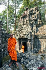 Two buddhist monks inside temple, Angkor, Cambodia