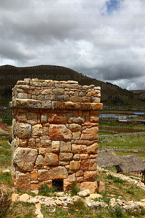 Square fieldstone chulpa or burial tower (probably Inca) at Molloko, near Acora, Peru
