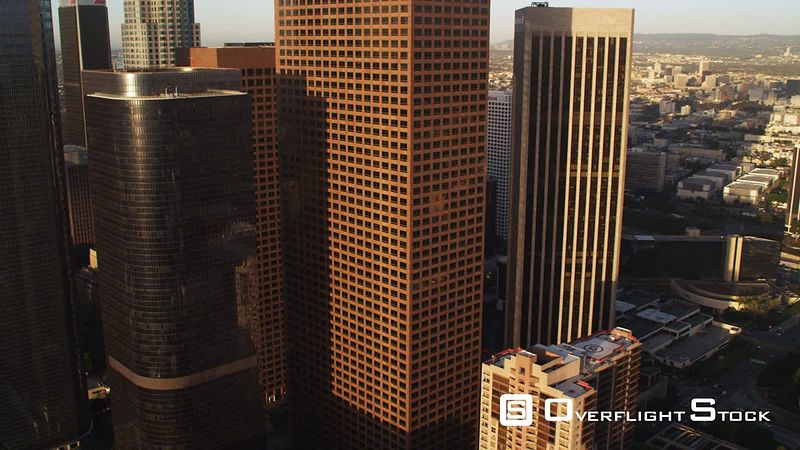 Approach and left-to-right flight past downtown Los Angeles skyscrapers. Shot in October