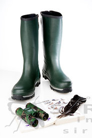 Rubber boots with birding equipment