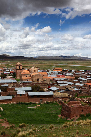 View over village , Santa Isabel church and altiplano , Pucará , Peru
