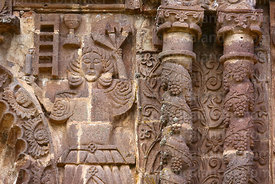 Detail of figure on upper right side of main entrance facade of Santa Cruz of Jerusalem church, Juli, Puno Region, Peru