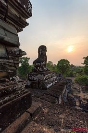 Lion statue and old ruins at sunset Angkor Wat, Cambodia