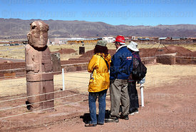 Tourists looking at the Fraile monolith, Tiwanaku, Bolivia