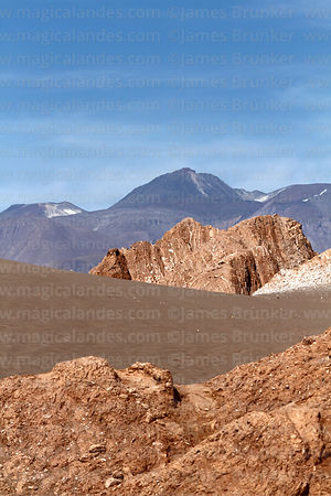 Rock formations in Valle de la Muerte / Death Valley and Sairecabur volcano, near San Pedro de Atacama, Region II, Chile