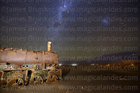 Milky Way and Magellanic Clouds above old steam train in train cemetery, Uyuni, Bolivia