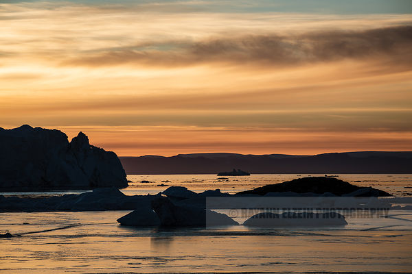 The many icebergs of the Ilulissat Icefjord under the last light of the day