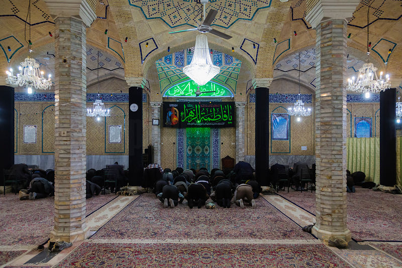 Men Praying inside the Masjed Mosque in Kerman