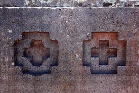 Andean crosses or Chakanas carved into stone block in Puma Punku temple, Tiwanaku, Bolivia