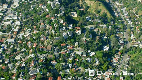 Red Epic Video residences in the Beachwood Canyon / Los feliz area Los Angeles California USA. Beachwood (also spelled Beechwood) Canyon is home to many movie industry people, actors, producers, etc Extremely rare view of the Hollywood Hills with lush green vegetation after winter rains!