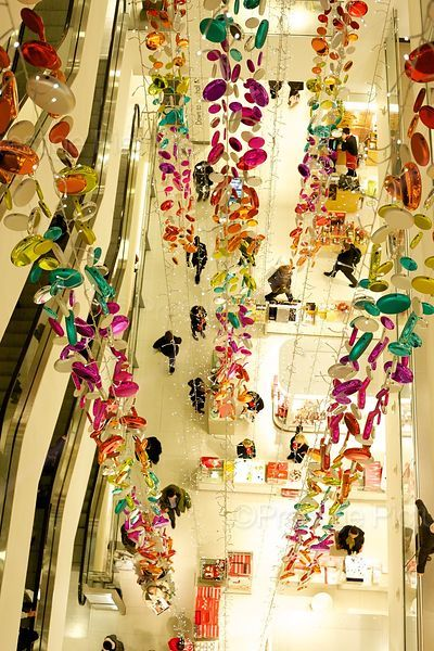 Hanging Christmas Decorations in London Department Store