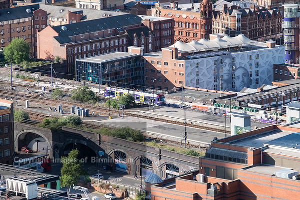 Aerial photograph of Birmingham City Centre, England. The Metro trains arriving in to Birmingham from the Jewellery Quarter.